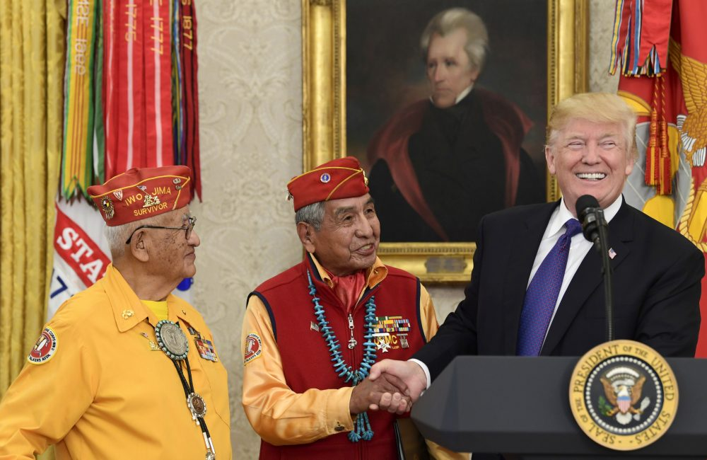 President Trump meets with Navajo code talkers Peter MacDonald, center, and Thomas Begay in the Oval Office Monday. (Susan Walsh/AP)