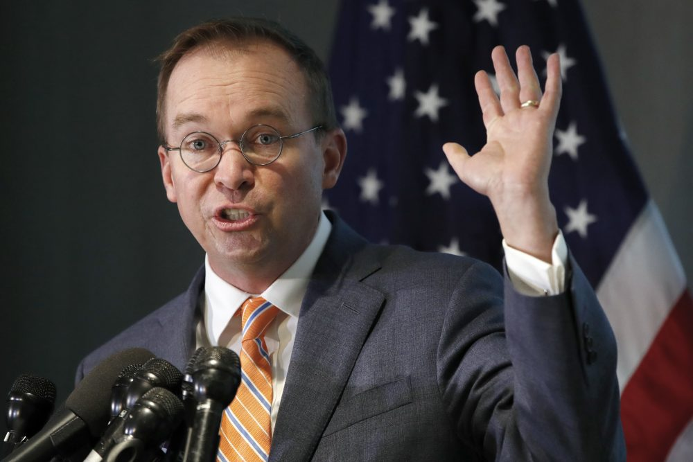 Mick Mulvaney holds up his hand as he speaks during a news conference after his first day as acting director of the Consumer Financial Protection Bureau in Washington, Monday, Nov. 27, 2017. (Jacquelyn Martin/AP)