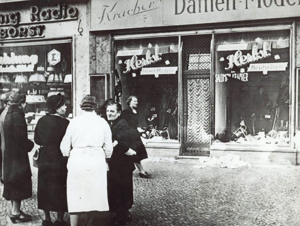 A group of people stand outside a Jewish-owned shop in an unnamed German town in November 1938, after the Kristallnacht, when Nazis burned and plundered hundreds of Jewish homes, shops and synagogues across the country. (AP)