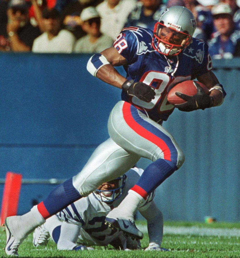 New England Patriots wide receiver Terry Glenn runs with the ball against the Denver Broncos at Foxborough Stadium Sunday, Oct. 24, 1999 in Foxborough, Mass.  (Jim Rogash/AP)