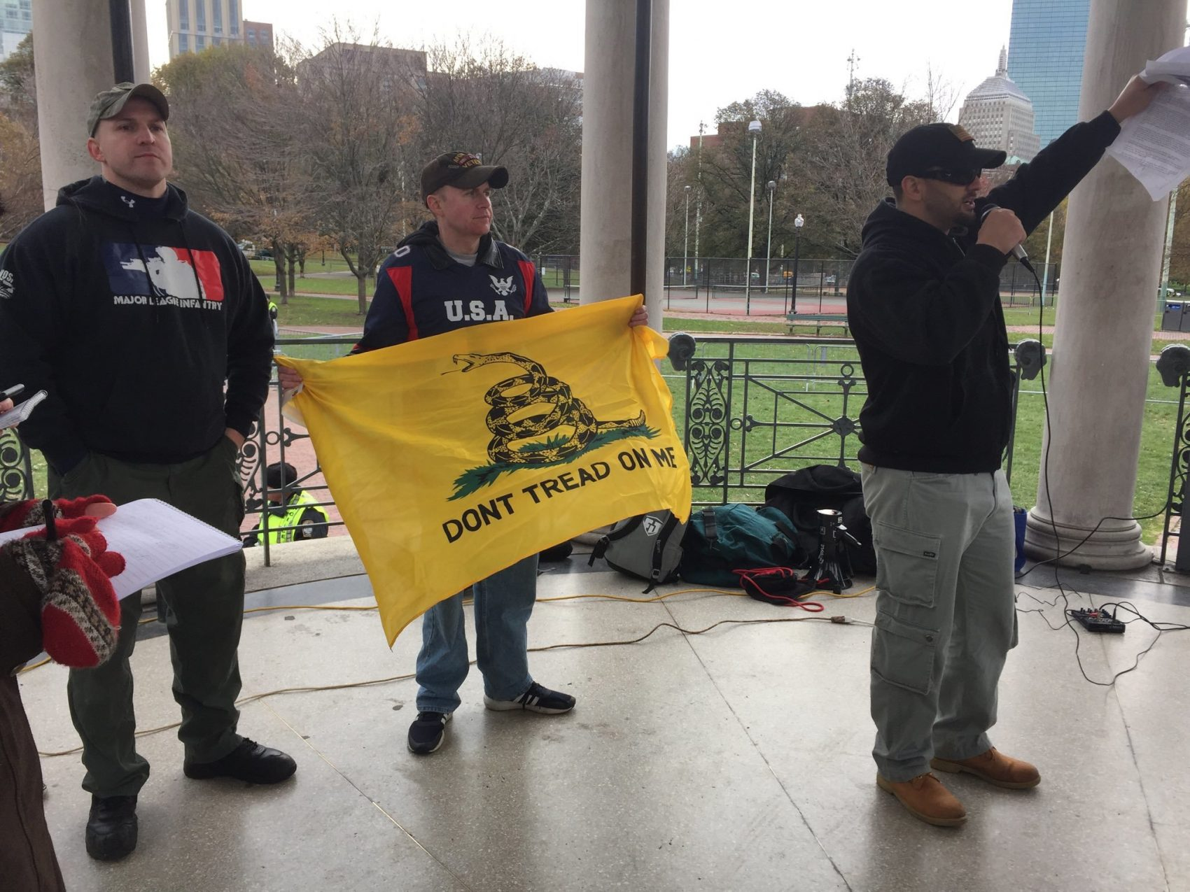 """Some of the speakers in the """"Anti-Marxist"""" rally on Boston Common. (Fred Thys/WBUR)"""