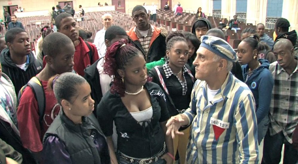 Steve Ross speaking with students at Jeremiah E. Burke High School. (Courtesy, Many Hats Productions)