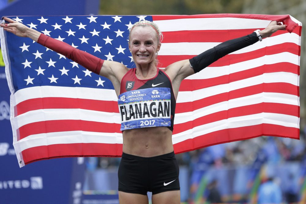 Shalane Flanagan of the United States poses for pictures after crossing the finish line first in the women's division of the New York City Marathon in New York, Sunday, Nov. 5, 2017. She is running the Boston Marathon on Monday. (Seth Wenig/AP)