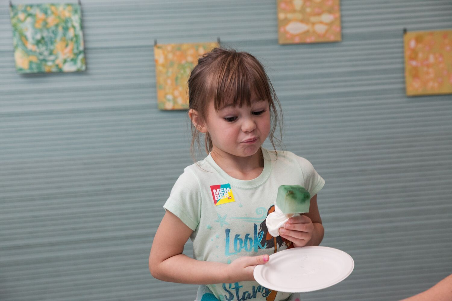 A museum visitor tastes the phytoplankton popsicle at the ICA. (Courtesy Galya Feierman/ICA)