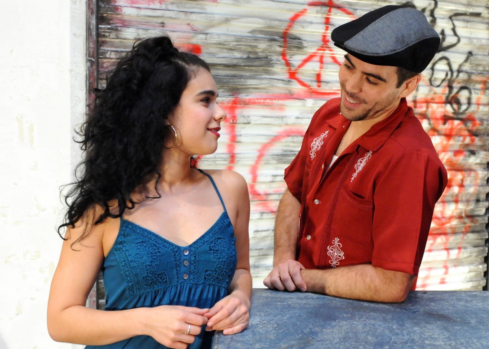 """Iliana Garcia as Vanessa and Diego Klock-Perez as Usnavi in Wheelock Family Theatre's production of """"In The Heights."""" (Courtesy Randy H. Goodman)"""