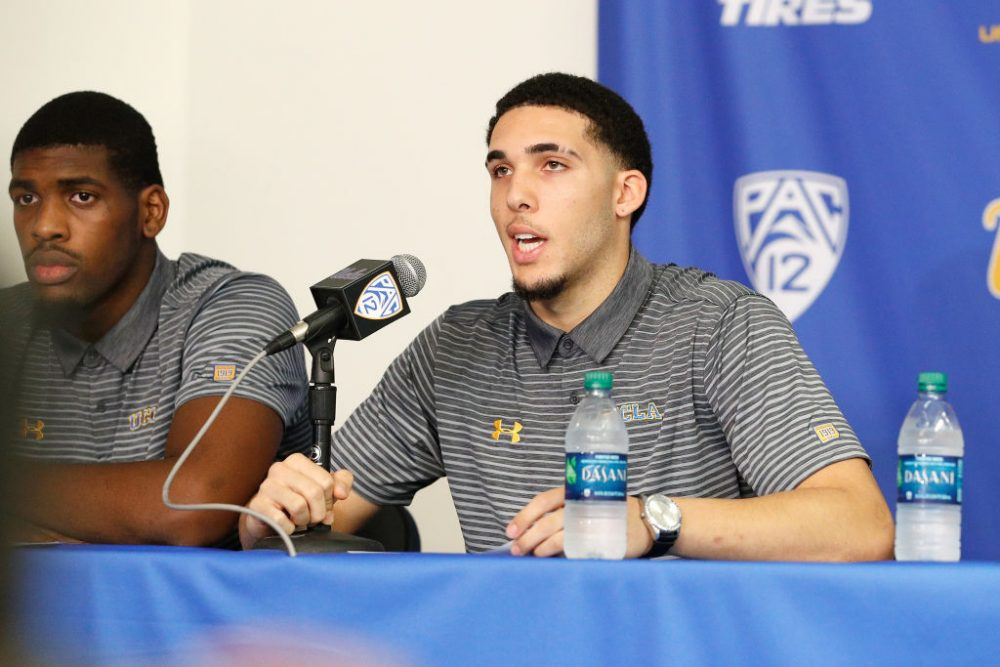 LiAngelo Ball (right) and Cody Riley of the UCLA Men's Basketball team speak to the media. Ball, Riley and Jalen Hill were suspended after allegedly shoplifting while on a school trip to China. (Josh Lefkowitz/Getty Images)