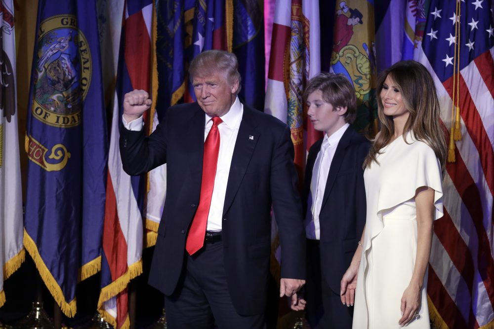 President-elect Donald Trump pumps his fist after giving his acceptance speech on Nov. 9, 2016 in New York, with his wife Melania Trump, right, and their son Barron follow him. (John Locher/AP)