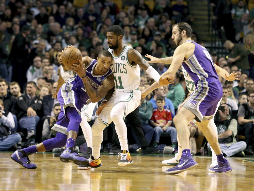 Sacramento Kings' George Hill (3) drives into Boston Celtics' Kyrie Irving (11) during the first half of an NBA basketball game in Boston, Wednesday, Nov. 1, 2017. (AP Photo/Mary Schwalm)
