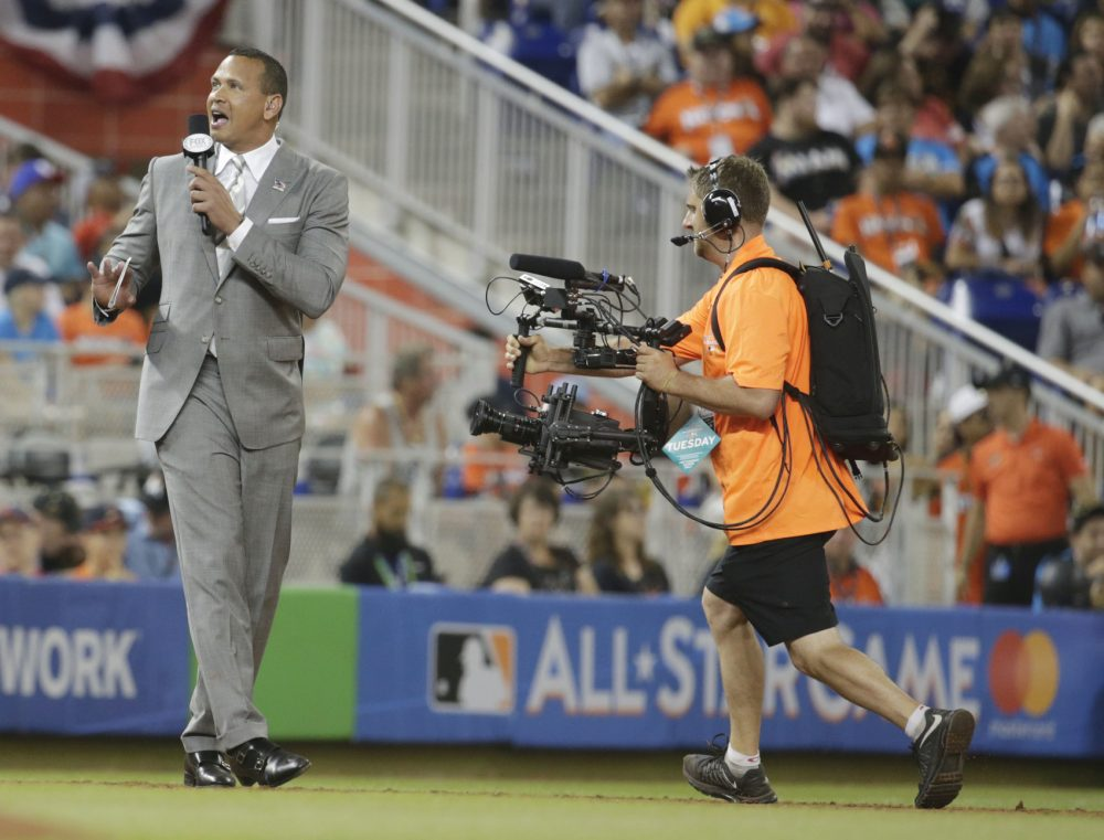 Former MLB player Alex Rodriguez, reports from the field during the MLB baseball All-Star Game, Tuesday, July 11, 2017, in Miami. (AP Photo/Lynne Sladky)