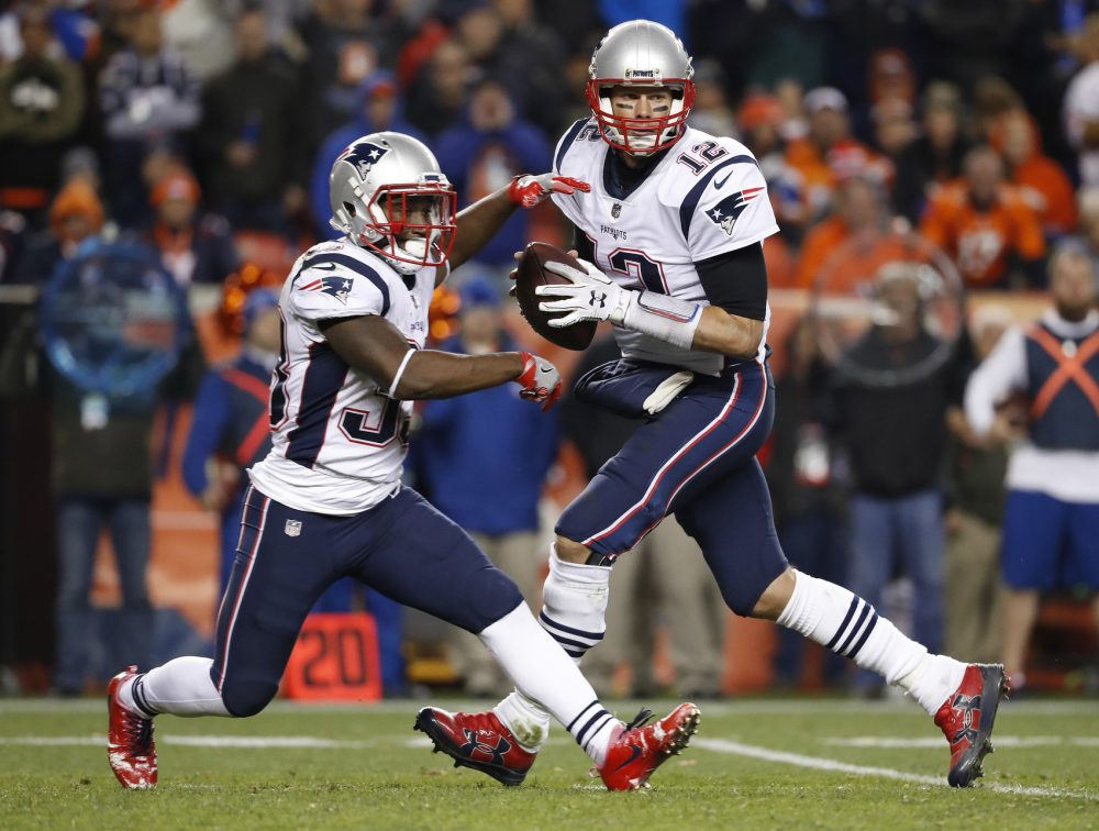 New England Patriots quarterback Tom Brady (12) looks to pass as running back Dion Lewis (33) runs during the second half of an NFL football game against the Denver Broncos, Sunday, Nov. 12, 2017, in Denver. (AP Photo/Jack Dempsey)