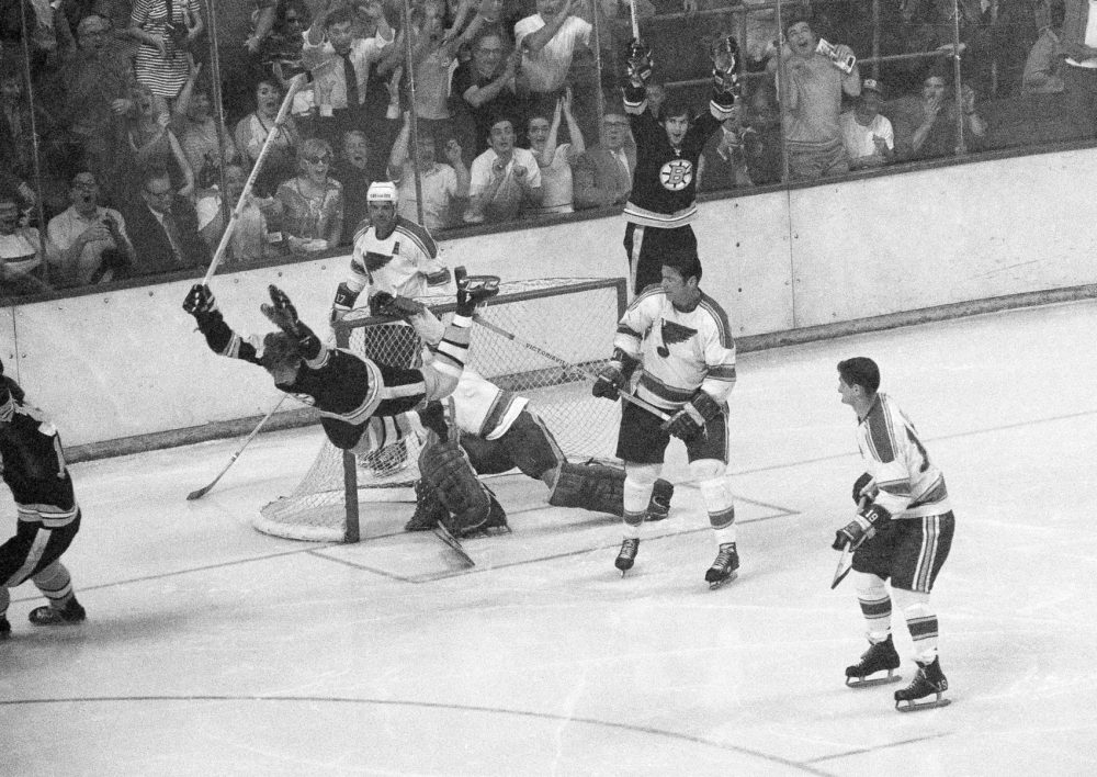 Boston Bruins' Bobby Orr flies through the air after driving the winning goal by St. Louis Blues' goalie Glenn Hall in the sudden death period of their NHL finals of the Stanley Cup Series in Boston Garden, May 10, 1970.  Boston won 4-3 to win the series four straight and return the Stanley Cup to Boston for the first time in 29 years.  Watching is Blues' Jean Guy. (AP Photo/A.E. Maloof)