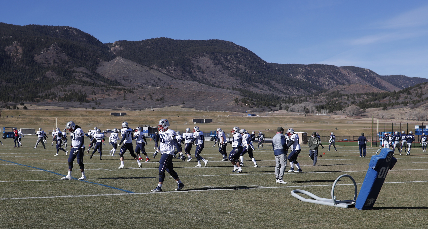 With the surrounding mountains in the background, the New England Patriots take part in drills at NFL football practice, Wednesday, Nov. 15, 2017, on the campus of the Air Force Academy in Air Force Academy, Colo. The Patriots are practicing at Air Force, which is located at an elevation of 7,200 feet, to prepare to face the Oakland Raiders during an NFL football game Sunday in Mexico City, which sits at an elevation of almost 7,400 feet above sea level. (AP Photo/David Zalubowski)