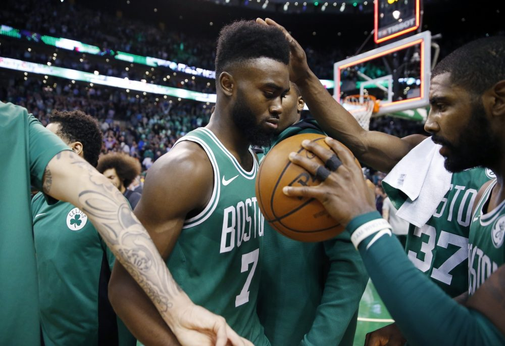 Boston Celtics' Kyrie Irving, right, gives the ball to teammate Jaylen Brown (7) after defeating the Golden State Warriors 92-88 during an NBA basketball game in Boston, Thursday, Nov. 16, 2017. (AP Photo/Michael Dwyer)