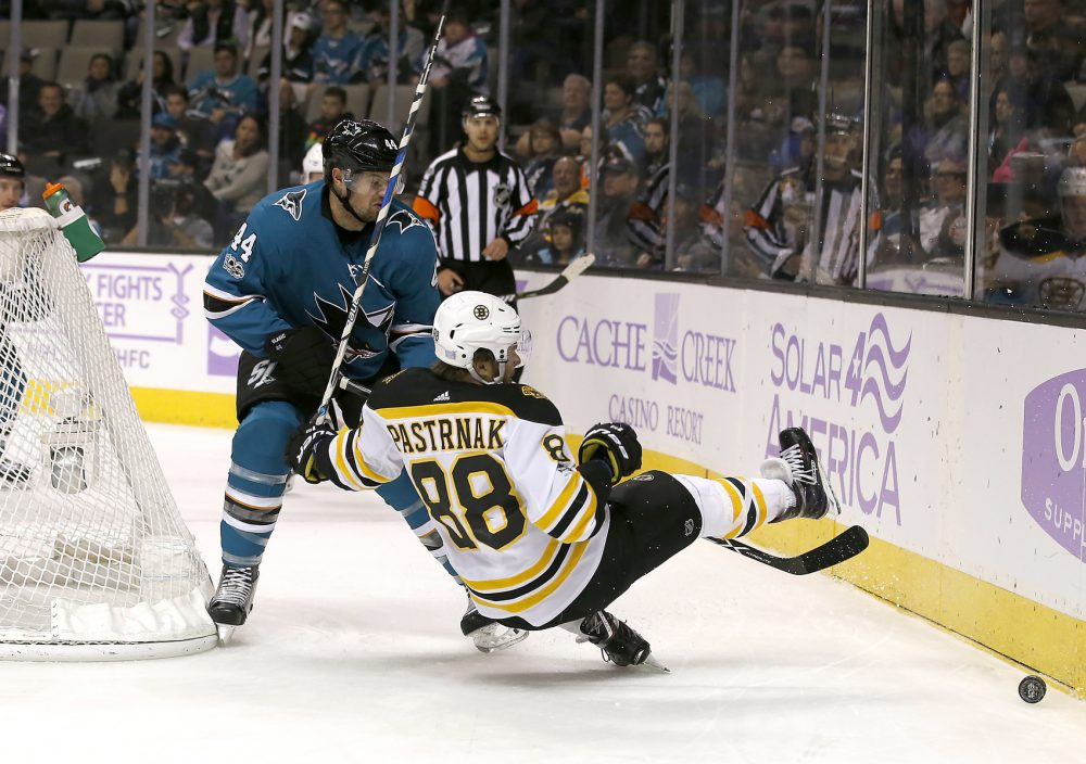 Boston Bruins right wing David Pastrnak (88), of the Czech Republic, collides with San Jose Sharks defenseman Marc-Edouard Vlasic (44) during the first period of an NHL hockey game Saturday, Nov. 18, 2017, in San Jose, Calif. (AP Photo/Tony Avelar)