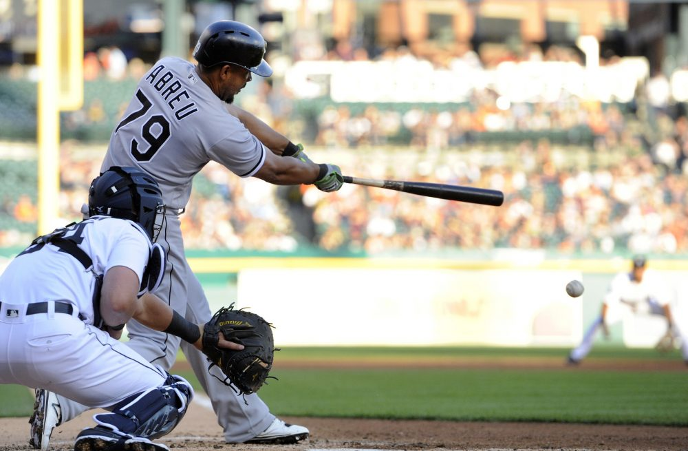 Chicago White Sox's Jose Abreu (79) hits an RBI single against the Detroit Tigers in the second inning of a baseball game, Saturday, Sept. 16, 2017, in Detroit. (AP Photo/Jose Juarez)