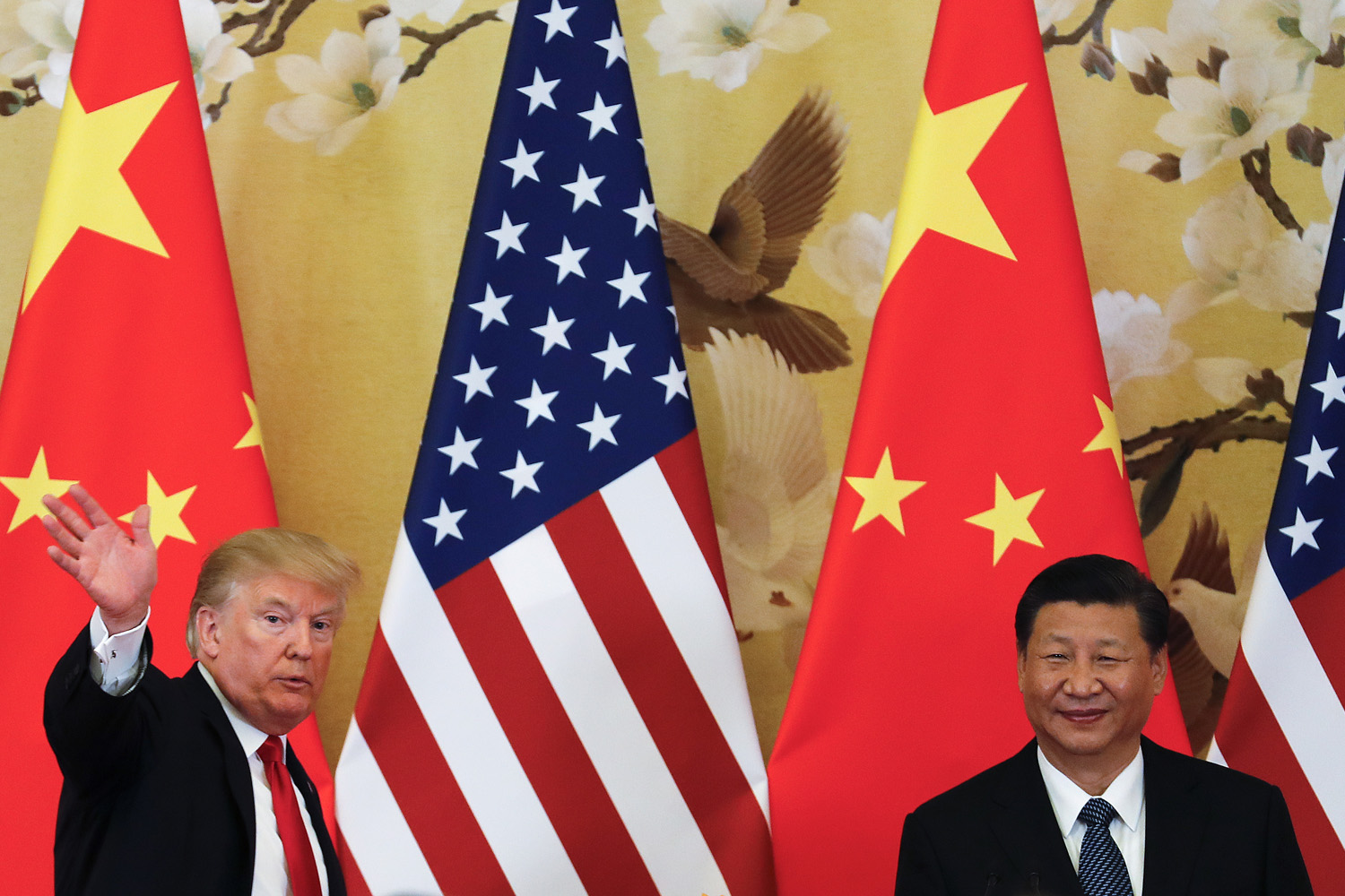U.S. President Donald Trump waves next to Chinese President Xi Jinping in Beijing. (Andy Wong/AP)