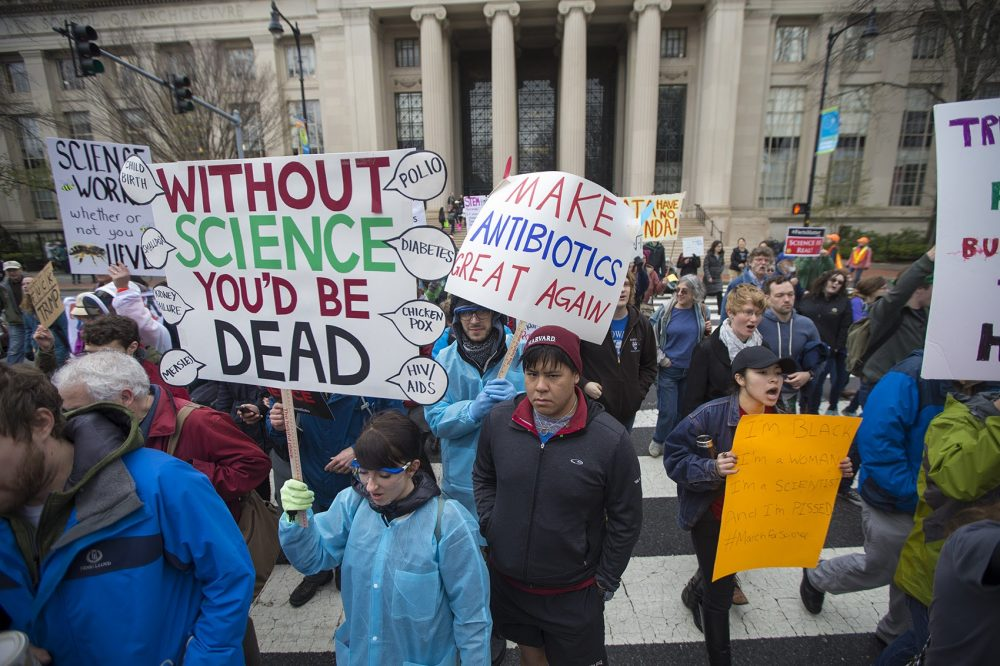 Harvard students, faculty and alumni arrive to meet with MIT protesters to continue thier march to the Boston Common for the March for Science Rally. (Jesse Costa/WBUR)