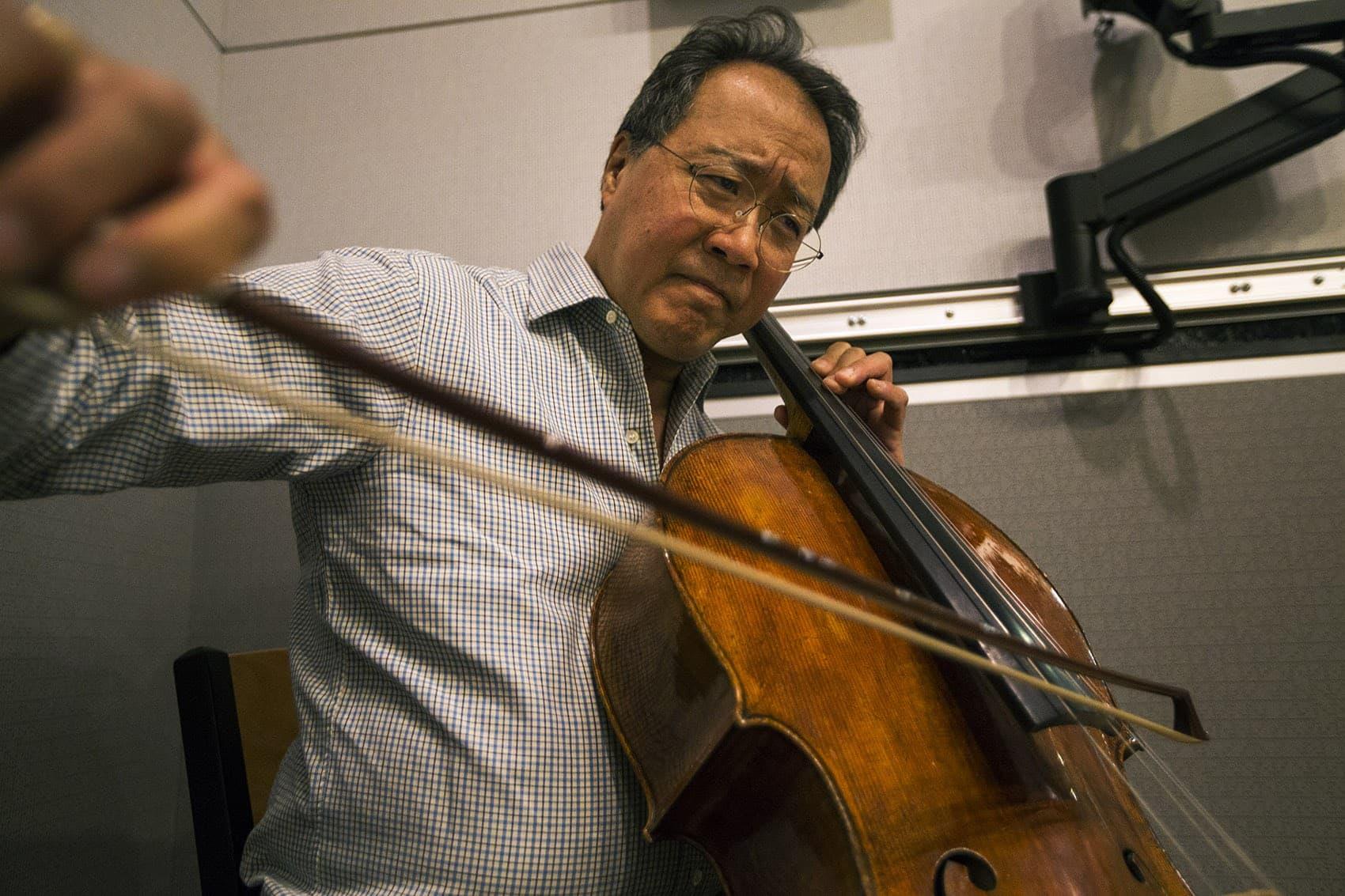 Yo-Yo Ma playing with Chris Thile and Edgar Meyer in the WBUR studios. (Jesse Costa/WBUR)