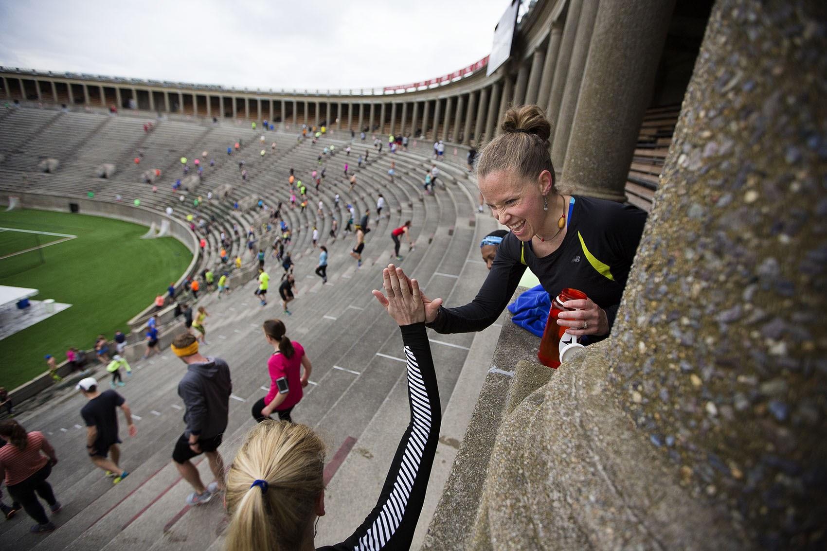 November Project participants climb stairs at Harvard Stadium in 2016. (Jesse Costa/WBUR).