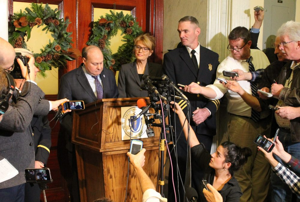 Senate President Stanley Rosenberg was flanked by an aide and court officers, and surrounded by media, during a press conference Friday about his husband's alleged sexual assaults and interference in Senate affairs. (Sam Doran/SHNS)