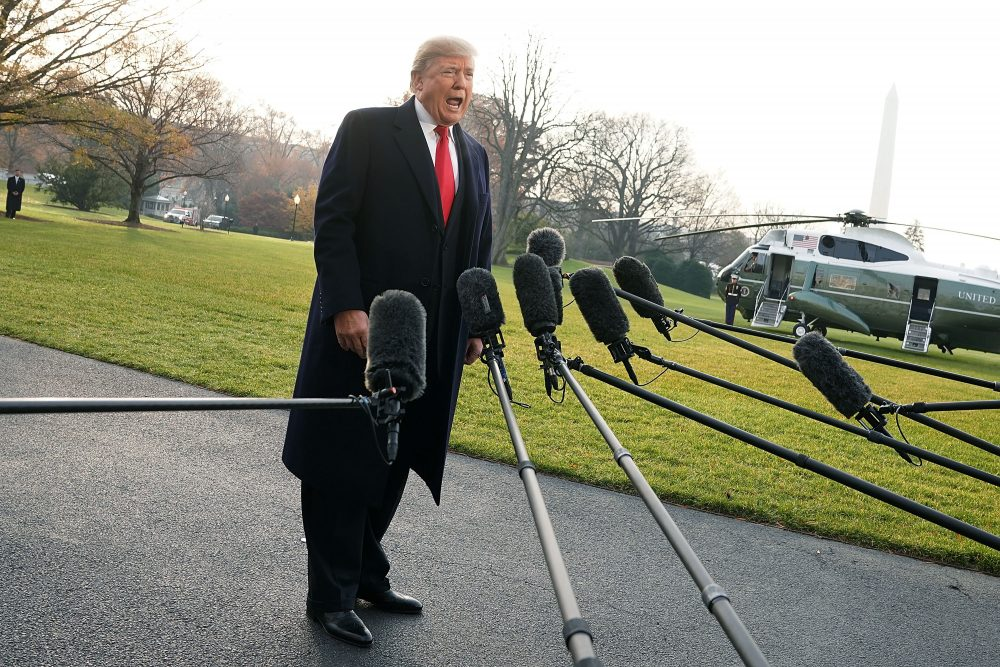 President Trump approaches members of the media to speak on former national security adviser Michael Flynn lying to the FBI, prior to his Marine One departure from the South Lawn of the White House on Dec. 4, 2017 in Washington, D.C. (Alex Wong/Getty Images)