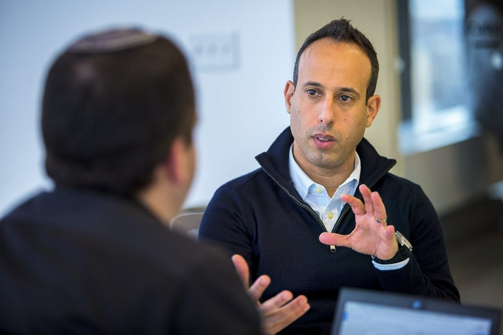 """In recent years, more than a dozen Israeli cybersecurity companies have made Massachusetts their home away from home. """"When you do the math, it's the proximity to Israel, the time differences - it makes a huge difference,"""" said Lior Div, founder & CEO of Cybereason. (Jesse Costa/WBUR)"""