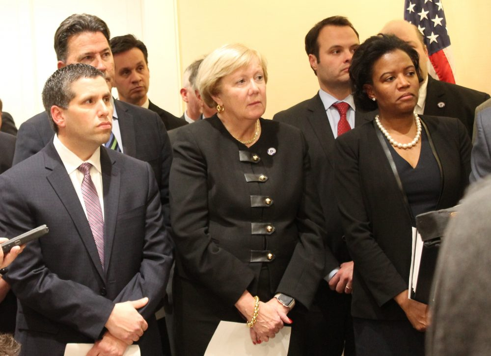 Sens. Sal DiDomenico, Eileen Donoghue, and Linda Dorcena Forry stood next to the podium Monday night while incoming Acting President Harriette Chandler talked to press. (Sam Doran/SHNS)