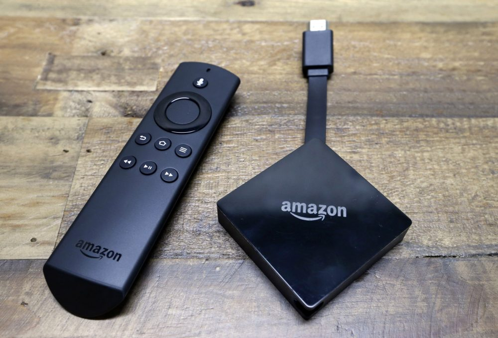 An Amazon Fire TV streaming device with its remote control. On Tuesday, Dec. 5, 2017, Google announced plans to pull its popular YouTube video service from Amazon's Fire TV and Echo Show devices in an escalating feud that has caught consumers in the crossfire. (Elaine Thompson/AP)
