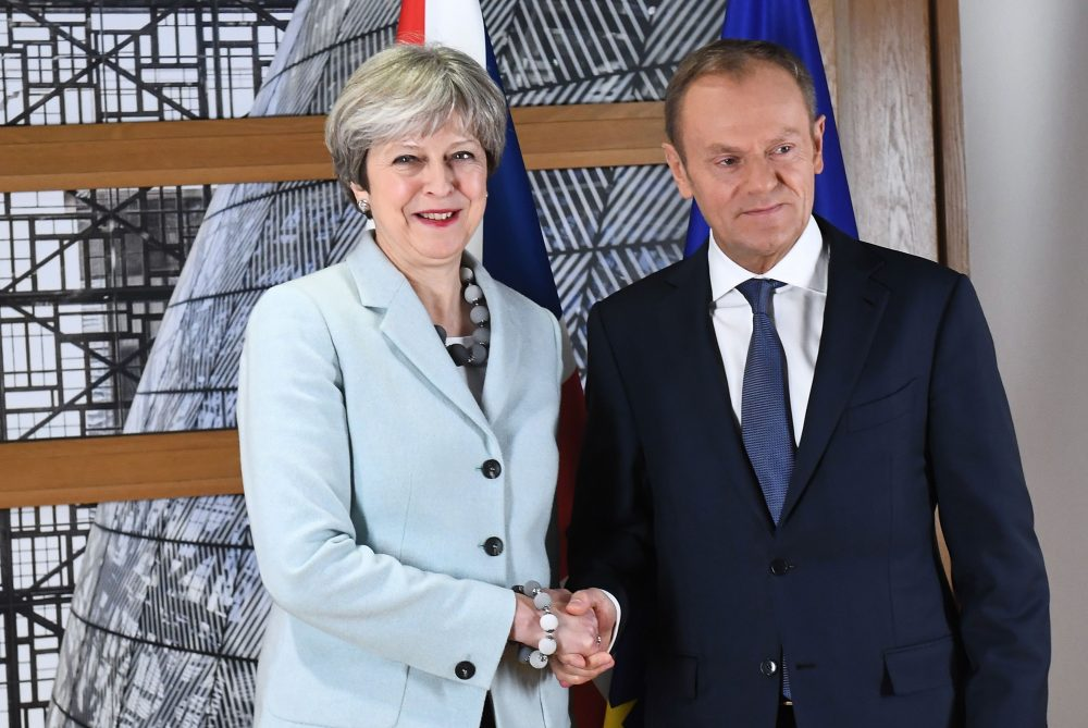 British Prime Minister Theresa May is welcomed by European Council President Donald Tusk at the European Council in Brussels on Dec. 8, 2017. (Emmanuel Dunand/AFP/Getty Images)