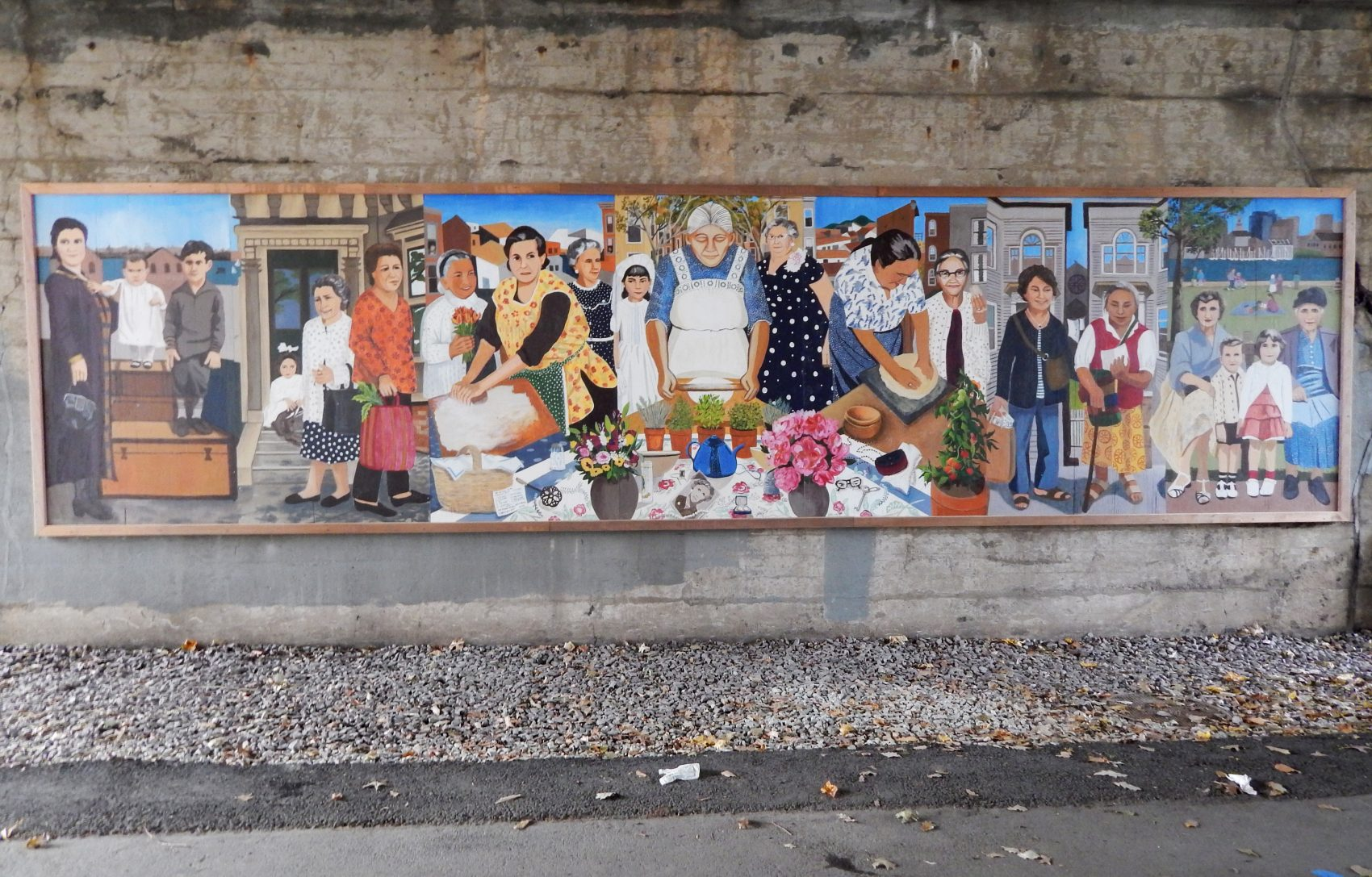 """Immigrant Grandmothers"" mural in East Boston. (Phaedra Scott/WBUR)"