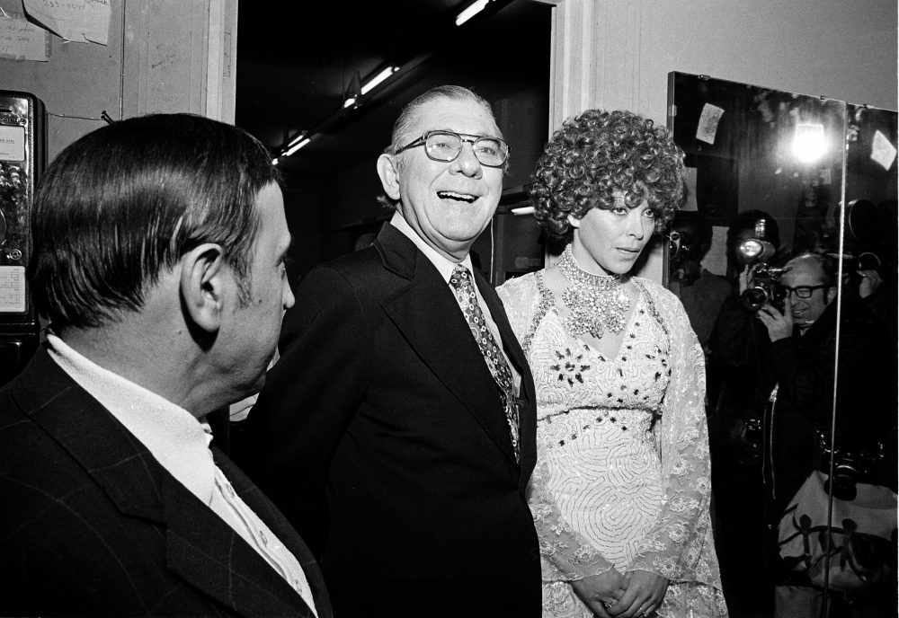 """Rep. Wilbur D. Mills (D-Ark.), stands with exotic dancer Fanne Foxe, also known as """"The Washington Tidal Basin Bombshell,"""" after one of her late-night performances in Boston on Dec. 2, 1974. (AP Photo)"""