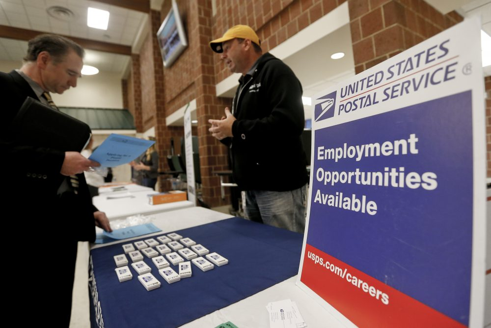 In this Thursday, Nov. 2, 2017, photo, a recruiter from the postal service, right, speaks with an attendee of a job fair in Cheswick, Pa. On Thursday, Dec. 7, 2017, the Labor Department reported that the number of unemployed workers filing for jobless benefits fell by 2,000 a week earlier to 236,000, the lowest level in five weeks and further evidence of the strength in the labor market. (Keith Srakocic/AP)