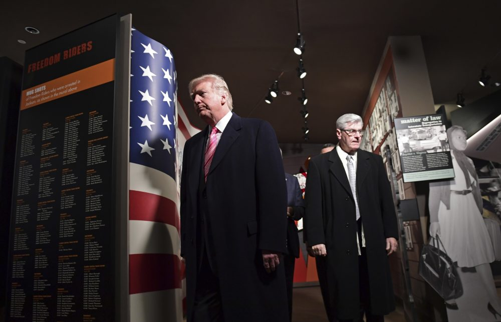 President Donald Trump, left, gets a tour of the newly-opened Mississippi Civil Rights Museum in Jackson, Miss., Saturday, Dec. 9, 2017. (Susan Walsh/AP)