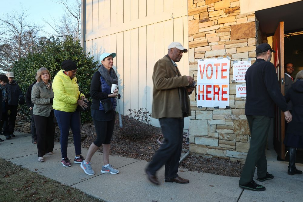 Voters head in to cast their ballot as the doors open at a polling station set up in the St. Thomas Episcopal Church on Dec. 12, 2017 in Birmingham, Ala. (Joe Raedle/Getty Images)