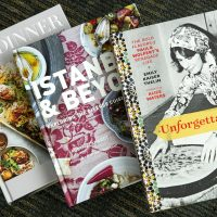 """Chef Kathy Gunst's top three cookbook picks for 2017 (left to right): """"Dinner: Changing the Game,"""" by Melissa Clark and Eric Wolfinger; """"Istanbul & Beyond: Exploring the Diverse Cuisines of Turkey,"""" by Robyn Eckhardt and David Hagerman; """"Unforgettable: The Bold Flavors of Paula Wolfert's Renegade Life,"""" by Emily Kaiser Thelin, Andrea Nguyen, Eric Wolfinger and Toni Tajima. (Robin Lubbock/WBUR)"""