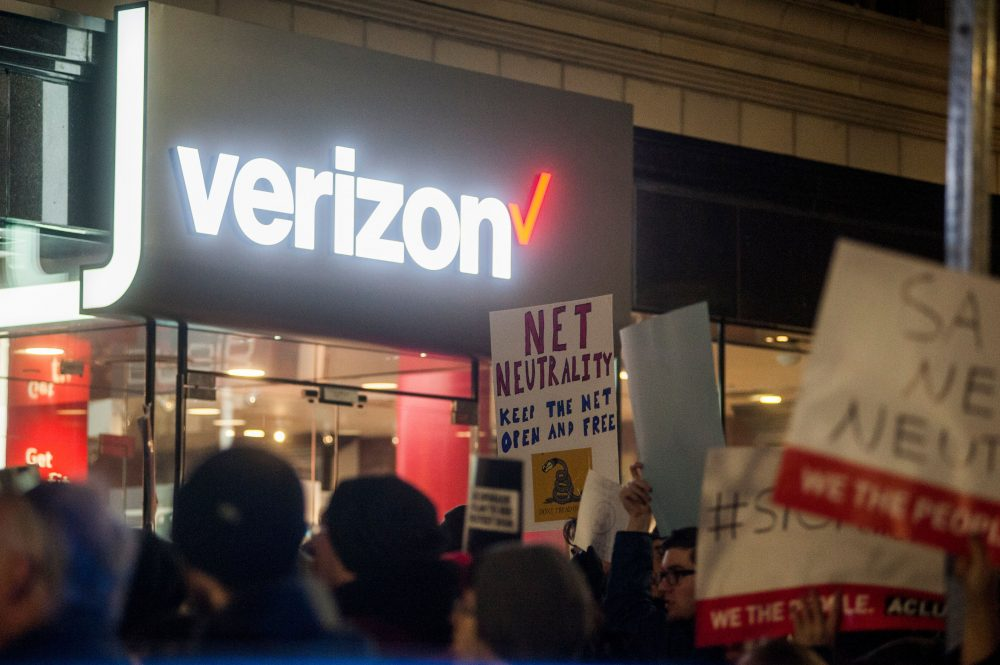 Protestors gather on Bolyston Street in front of a Verizon store during a Net neutrality rally on December 7, 2017 in Boston, Mass. (Ryan McBride/AFP/Getty Images)