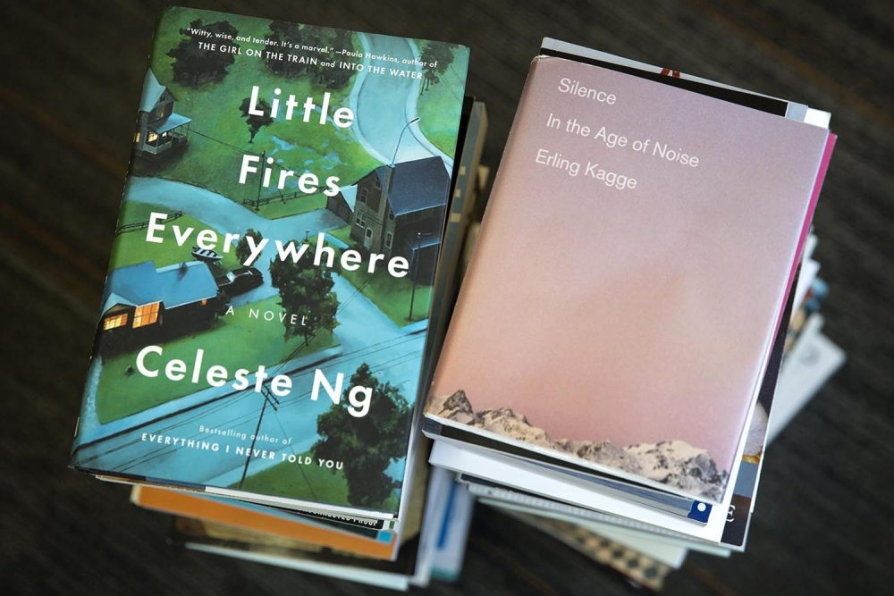 Little Fires Everywhere, by Celeste Ng, and Silence In The Age Of Noise, by Erling Kagge. (Robin Lubbock/WBUR)