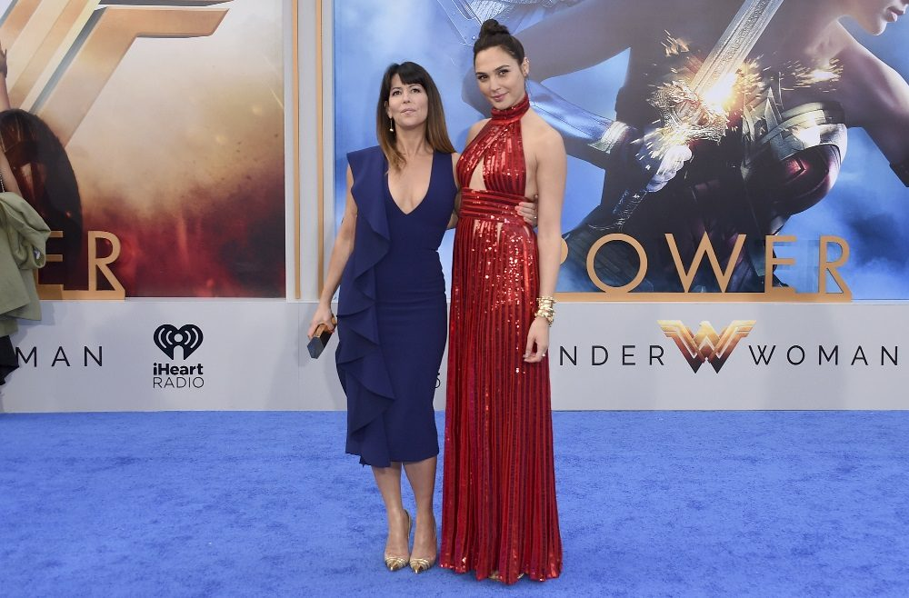 """In this May 25, 2017 file photo, director Patty Jenkins, left, and actress Gal Gadot arrive at the world premiere of """"Wonder Woman"""" at the Pantages Theatre in Los Angeles. The film grossed $103.1 million in North America over its debut weekend, a figure that easily surpassed industry expectations, set a new record for a film directed by a woman and bested all previous stand-alone female superhero movies put together. (Photo by Jordan Strauss/Invision/AP, File)"""