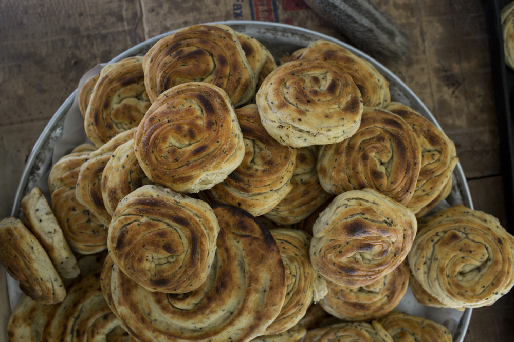 """Savory coiled fennel and nigella buns, from """"Istanbul & Beyond: Exploring the Diverse Cuisines of Turkey,"""" by Robyn Eckhardt and David Hagerman. (Courtesy David Hagerman)"""