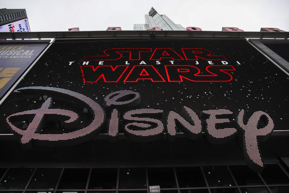 The Disney logo is displayed outside the Disney Store in Times Square, Dec. 14, 2017 in New York City. The Walt Disney Company announced on Thursday that it had reached a deal to purchase most of the assets of 21st Century Fox. The deal has a total value of around $66 billion, with Disney assuming $13.7 billion of Fox's net debt. (Drew Angerer/Getty Images)