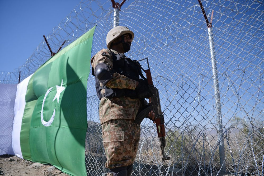 A Pakistani soldier keeps vigil next to a newly fenced border fencing along with Afghan's Paktika province border in Angoor Adda in Pakistan's South Waziristan tribal agency on Oct. 18, 2017. (Aamir Qureshi/AFP/Getty Images)