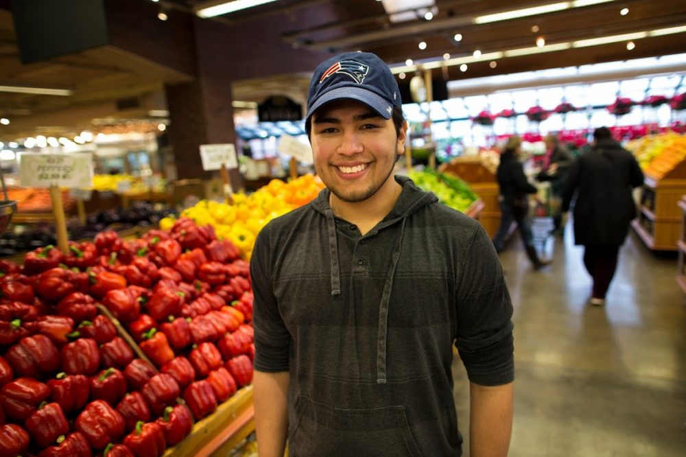 "Guilherme ""Gillie"" Assuncao, who's 23, at Russo's in Watertown (Jesse Costa/WBUR)"