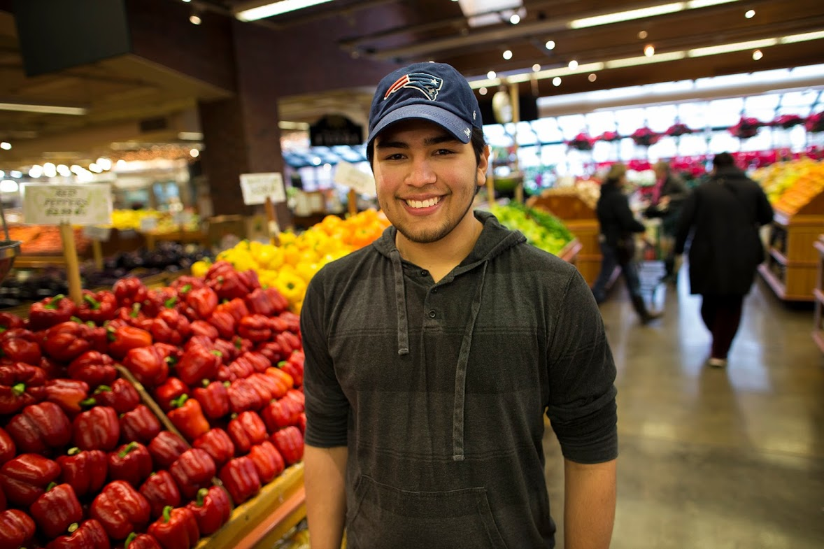 """Guilherme """"Gillie"""" Assuncao, who's 23, at Russo's in Watertown (Jesse Costa/WBUR)"""