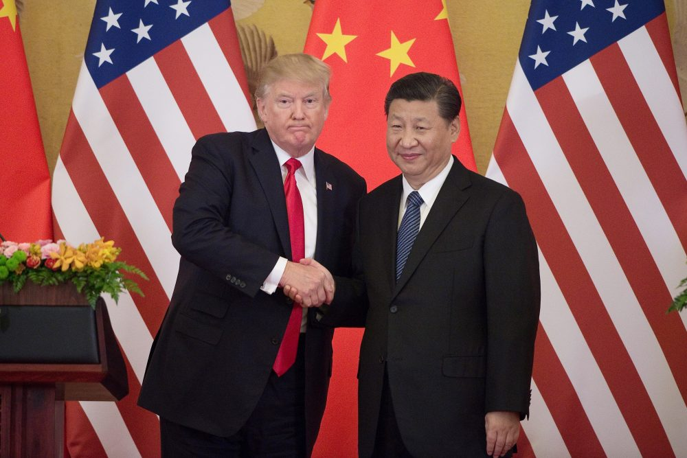 President Trump shakes hands with China's President Xi Jinping during a press conference at the Great Hall of the People in Beijing on Nov. 9, 2017. (Nicolas Asfouri/AFP/Getty Images)