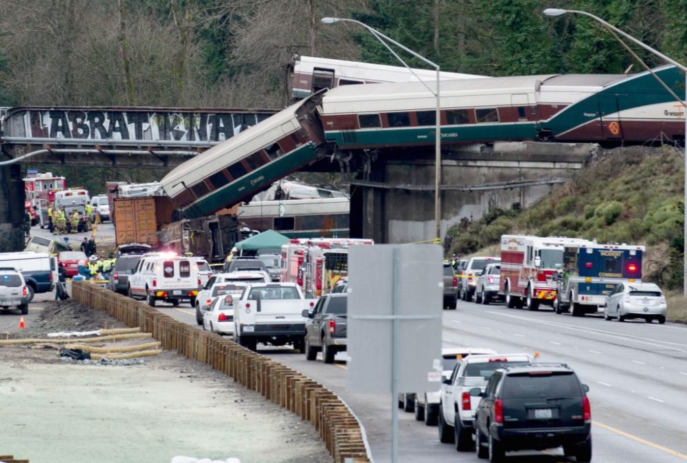 The scene of a portion of the Interstate 5 highway after an Amtrak train derailed from an overpass early Dec. 18, 2017 near the city of Tacoma, Wash. (Kathryn Elsesser/AFP/Getty Images)