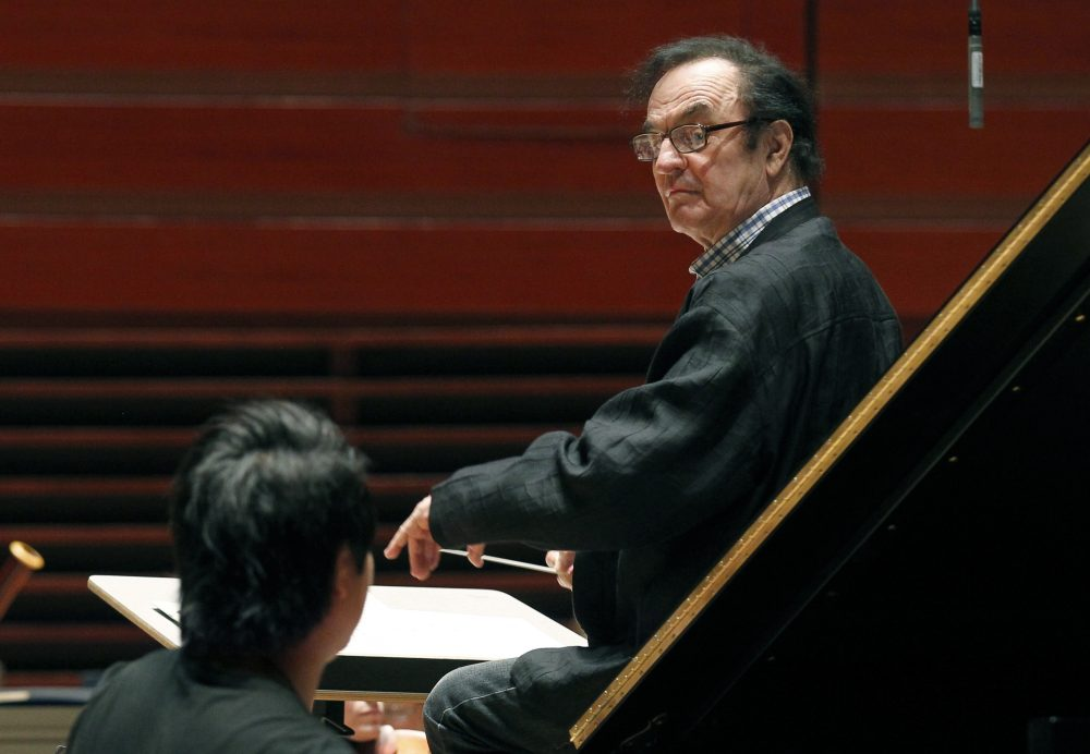In this October, 2011 photo, world-renowned conductor Charles Dutoit performs with the Philadelphia Orchestra during a rehearsal. (Alex Brandon/AP)