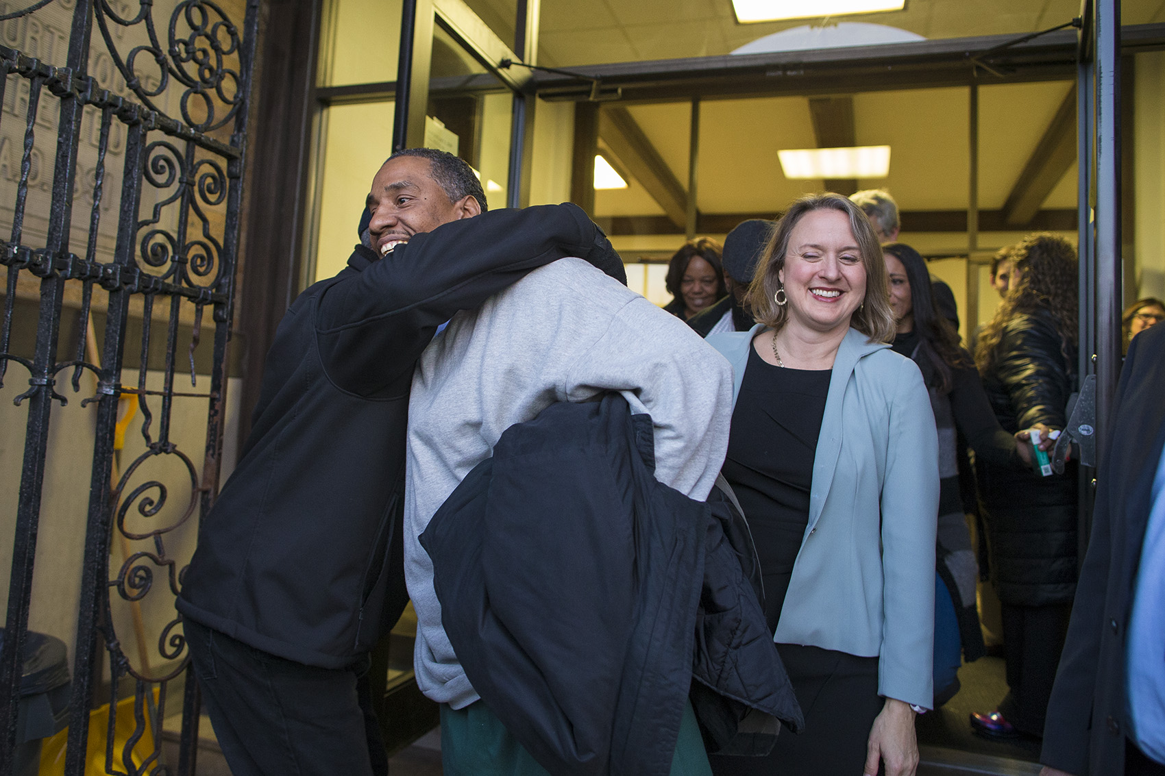 Darrell Jones walks out of the Plymouth County Superior Court in Brockton with his attorney Lisa Kavanaugh after he was released on bail Thursday after being incarcerated for 32 years for a crime he maintains he did not commit. (Jesse Costa/WBUR)