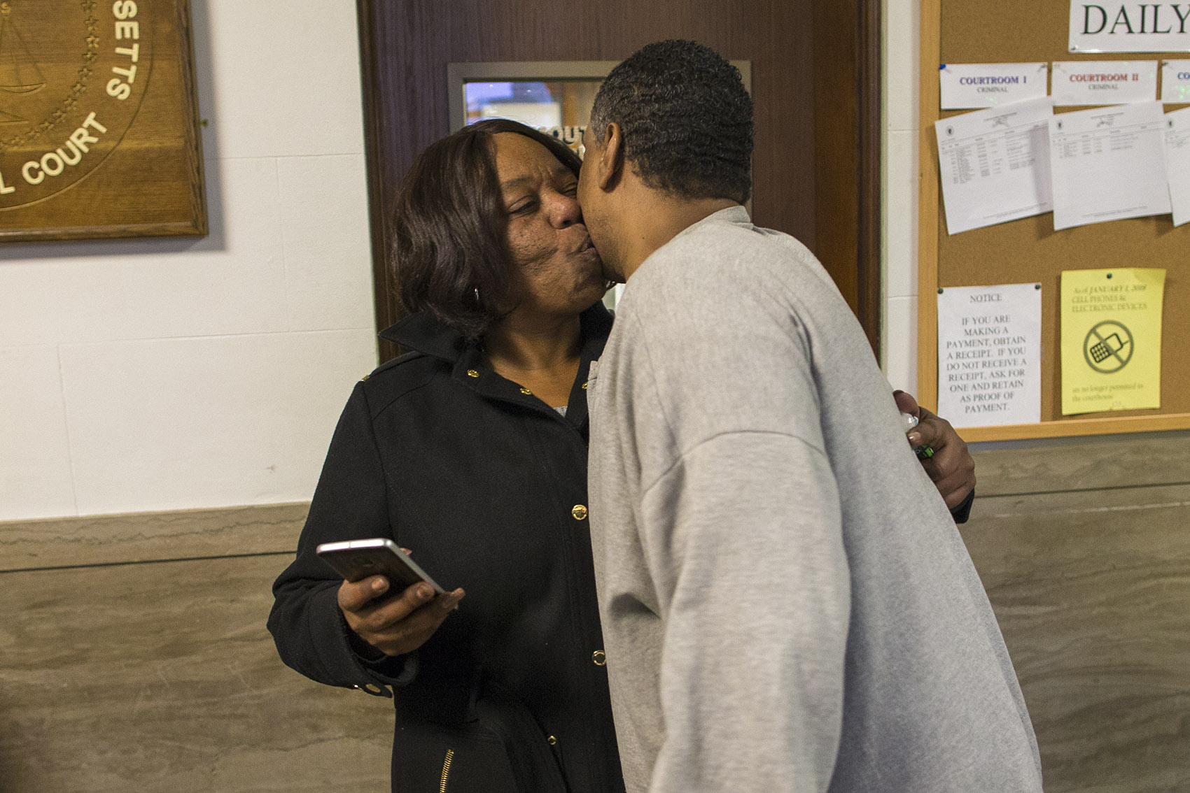 Darrell Jones embraces and kisses his sister Classie Howard after he was released on bail. (Jesse Costa/WBUR)
