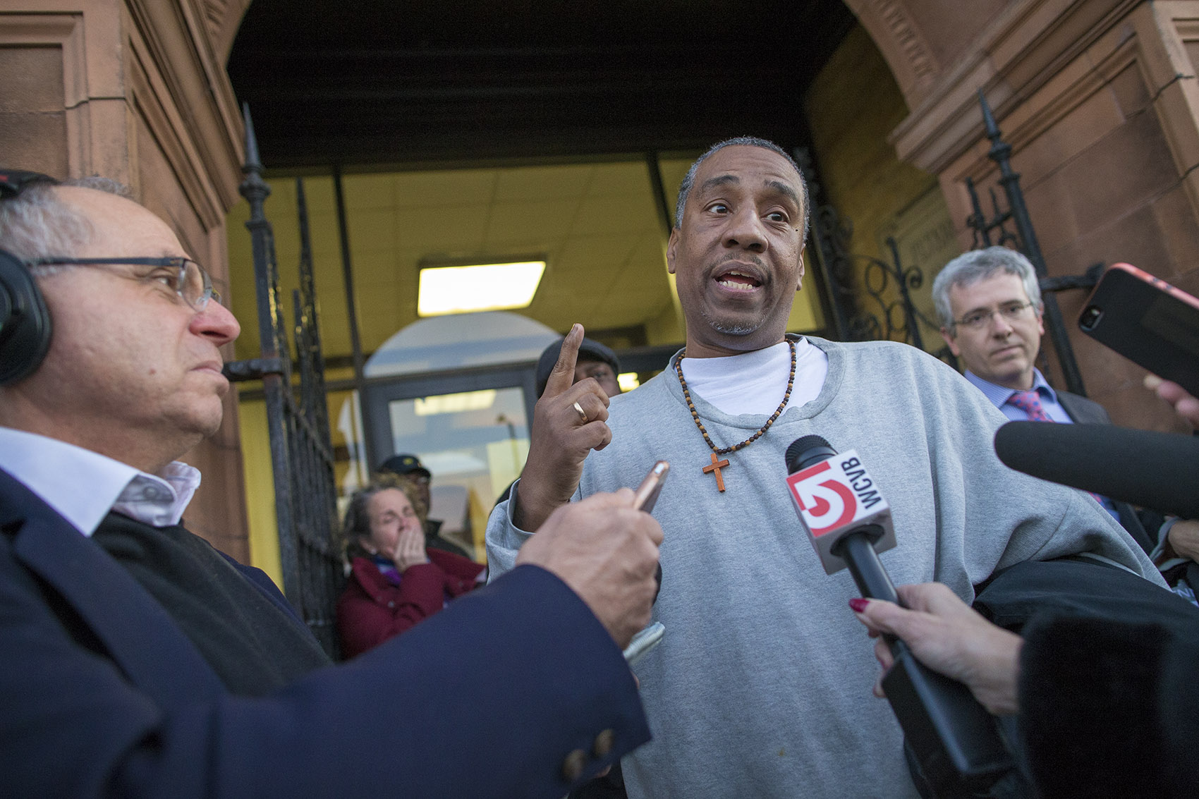 Darrell Jones speaks to the media in front of the Brockton Superior Courthouse after his release. (Jesse Costa/WBUR)
