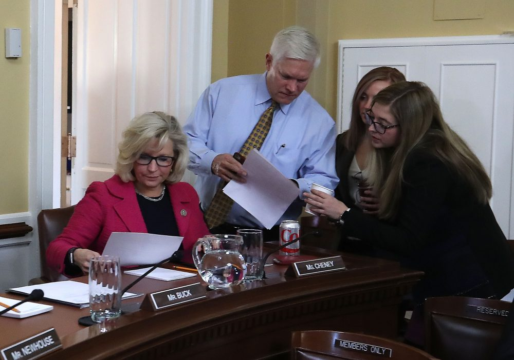 House Rules Committee Chairman Pete Sessions (R-Texas) (center), talks with staffers as Rep. Liz Cheney (R-Wyo.) (left) sits nearby as negotiations continue on funding the government to avert a shutdown at midnight on Friday night, at the U.S. Capitol on Dec. 21, 2017 in Washington, D.C. (Mark Wilson/Getty Images)
